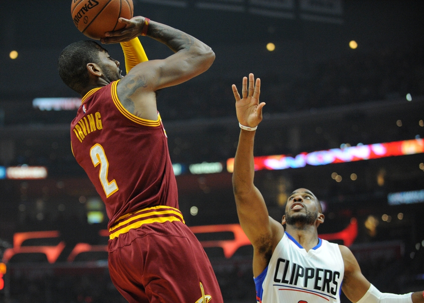 March 13, 2016; Los Angeles, CA, USA; Cleveland Cavaliers guard Kyrie Irving (2) shoots a basket against Los Angeles Clippers guard Chris Paul (3) during the first half at Staples Center. Mandatory Credit: Gary A. Vasquez-USA TODAY Sports