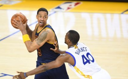 June 2, 2016; Oakland, CA, USA; Cleveland Cavaliers forward Channing Frye (9) controls the ball against Golden State Warriors forward Harrison Barnes (40) during the first half in game two of the NBA Finals at Oracle Arena. Mandatory Credit: Bob Donnan-USA TODAY Sports