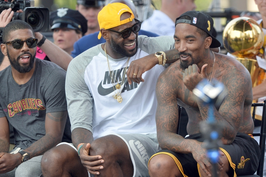 Jun 22, 2016; Cleveland, OH, USA; Cleveland Cavaliers guard Kyrie Irving, forward LeBron James and guard J.R. Smith laugh during the Cleveland Cavaliers NBA championship celebration in downtown Cleveland. Mandatory Credit: Ken Blaze-USA TODAY Sports