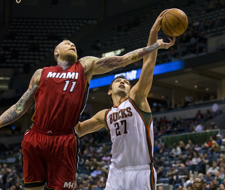 Mar 24, 2015; Milwaukee, WI, USA; Miami Heat forward Chris Andersen (11) and Milwaukee Bucks center Zaza Pachulia (27) reach for a rebound during the third quarter at BMO Harris Bradley Center. Mandatory Credit: Jeff Hanisch-USA TODAY Sports