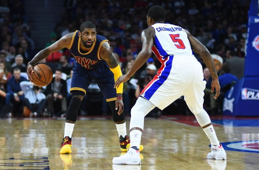 Apr 22, 2016; Auburn Hills, MI, USA; Cleveland Cavaliers guard Kyrie Irving (2) brings the ball up court as Detroit Pistons guard Kentavious Caldwell-Pope (5) defends during the first quarter in game three of the first round of the NBA Playoffs at The Palace of Auburn Hills. Mandatory Credit: Tim Fuller-USA TODAY Sports