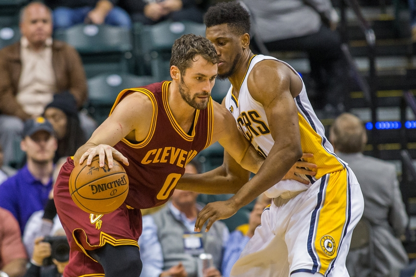 Nov 16, 2016; Indianapolis, IN, USA; Cleveland Cavaliers forward Kevin Love (0) dribbles the ball while Indiana Pacers forward Thaddeus Young (21) defends in the second half of the game at Bankers Life Fieldhouse. the Indiana Pacers beat the Cleveland Cavaliers 103-93. Mandatory Credit: Trevor Ruszkowski-USA TODAY Sports