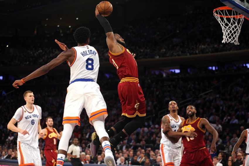 Dec 7, 2016; New York, NY, USA; Cleveland Cavaliers small forward LeBron James (23) drives against New York Knicks shooting guard Justin Holiday (8) during the second quarter at Madison Square Garden. Mandatory Credit: Brad Penner-USA TODAY Sports
