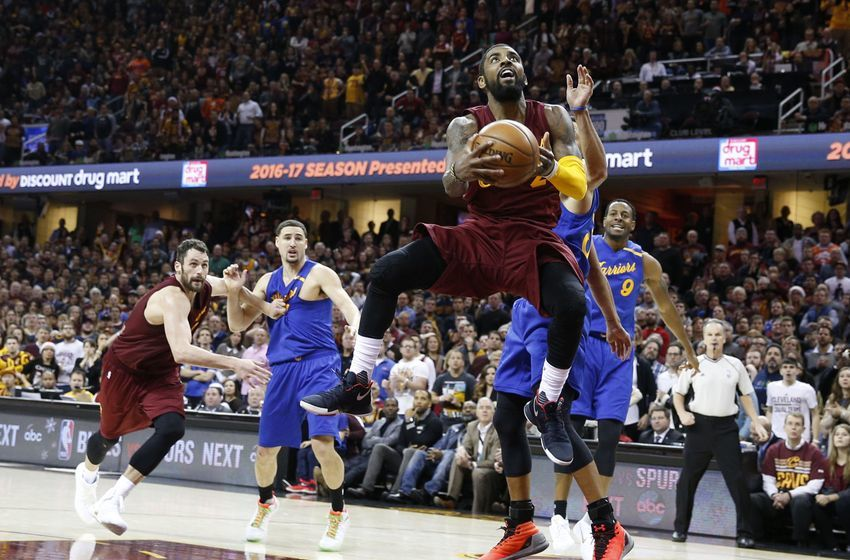 Dec 25, 2016; Cleveland, OH, USA; Cleveland Cavaliers guard Kyrie  Irving (2) takes a shot against Golden State Warriors guard <a rel=