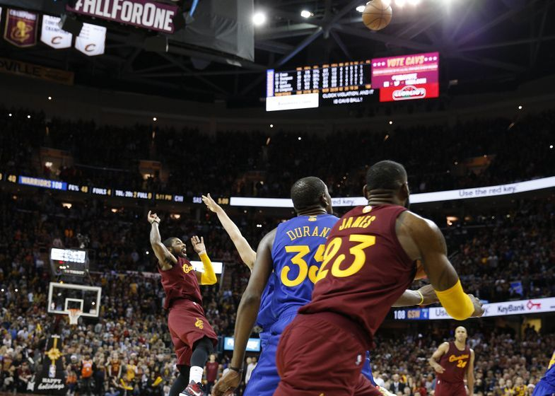 Dec 25, 2016; Cleveland, OH, USA; Cleveland Cavaliers guard Kyrie Irving (2) makes the winning shot against Golden State Warriors guard Klay Thompson (11) at Quicken Loans Arena. Cleveland defeats Golden State 109-108. Mandatory Credit: Brian Spurlock-USA TODAY Sports
