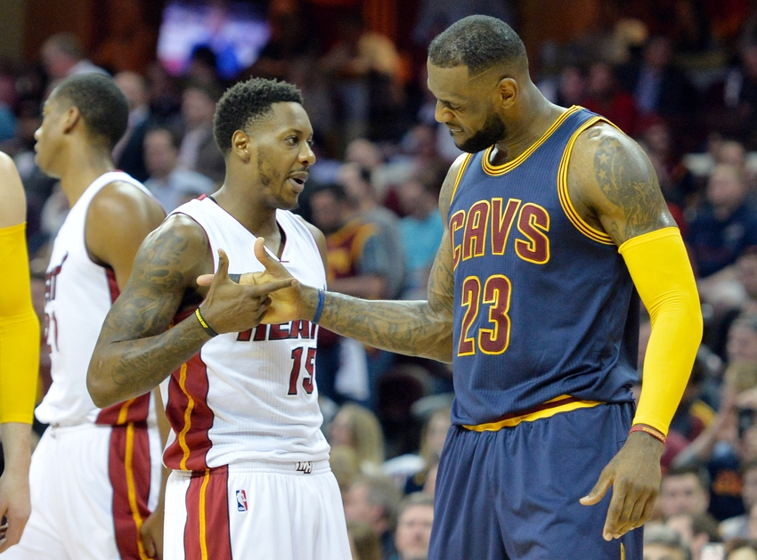 Apr 2, 2015; Cleveland, OH, USA; Cleveland Cavaliers forward LeBron James (23) shakes hands with Miami Heat guard Mario Chalmers (15) in the first quarter at Quicken Loans Arena. Mandatory Credit: David Richard-USA TODAY Sports