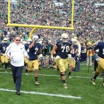 Sep 21, 2013; South Bend, IN, USA; Notre Dame Fighting Irish coach Brian Kelly leads his team onto the field before the game against the Michigan State Spartans at Notre Dame Stadium. Mandatory Credit: Brian Spurlock-USA TODAY Sports