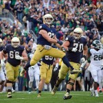 Sep 21, 2013; South Bend, IN, USA; Notre Dame Fighting Irish running back Cam McDaniel (33) celebrates after a touchdown in the fourth quarter against the Michigan State Spartans. Notre Dame won 17-13. Mandatory Credit: Matt Cashore-USA TODAY Sports