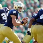 Sep 28, 2013; South Bend, IN, USA; Notre Dame Fighting Irish quarterback Andrew Hendrix (12) rolls out to hand off against the Oklahoma Sooners at Notre Dame Stadium. Mandatory Credit: Brian Spurlock-USA TODAY Sports