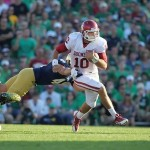 Sep 28, 2013; South Bend, IN, USA; Oklahoma Sooners quarterback Blake Bell (10) runs with the ball against the Notre Dame Fighting Irish at Notre Dame Stadium. Oklahoma defeats Notre Dame 35-21. Mandatory Credit: Brian Spurlock-USA TODAY Sports