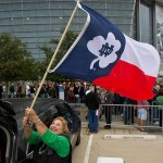 Oct 5, 2013; Arlington, TX, USA; Barbara Burns of San Antonio, Texas, takes down her Notre Dame themed Texas state flag outside AT
