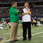 Oct 5, 2013; Arlington, TX, USA; Notre Dame Fighting Irish head coach Brian Kelly and Arizona State Sun Devils head coach Todd Graham chat before the game at AT