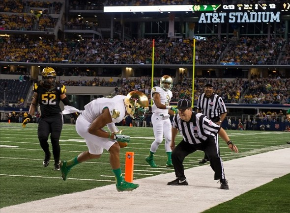 Oct 5, 2013; Arlington, TX, USA; Notre Dame Fighting Irish wide receiver TJ Jones (7) scores a touchdown in the second quarter against the Arizona State Sun Devils at AT
