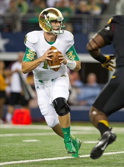 Oct 5, 2013; Arlington, TX, USA; Notre Dame Fighting Irish quarterback Tommy Rees (11) drops back in the first quarter against the Arizona State Sun Devils at AT