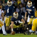 Oct 19, 2013; South Bend, IN, USA; Notre Dame Fighting Irish quarterback Tommy Rees (11) signals in the first quarter against the USC Trojans at Notre Dame Stadium. Mandatory Credit: Matt Cashore-USA TODAY Sports
