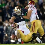 Oct 19, 2013; South Bend, IN, USA; Notre Dame Fighting Irish defensive end Stephon Tuitt (7) sacks USC Trojans quarterback Cody Kessler (6) in the fourth quarter at Notre Dame Stadium. Notre Dame won 14-10. Mandatory Credit: Matt Cashore-USA TODAY Sports