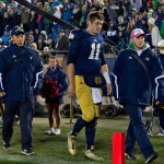 Oct 19, 2013; South Bend, IN, USA; Notre Dame Fighting Irish quarterback Tommy Rees (11) leaves the field after being injured in the third quarter against the USC Trojans at Notre Dame Stadium. Notre Dame won 14-10. Mandatory Credit: Matt Cashore-USA TODAY Sports