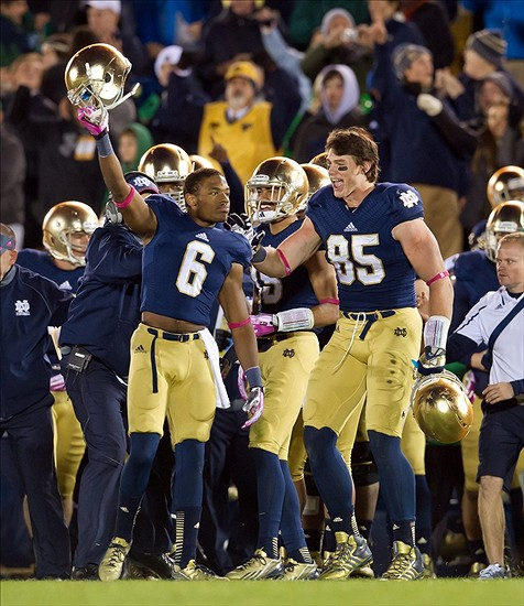 Oct 19, 2013; South Bend, IN, USA; Notre Dame Fighting Irish cornerback KeiVarae Russell (6) and tight end Troy Niklas (85) celebrate in the fourth quarter against the USC Trojans at Notre Dame Stadium. Notre Dame won 14-10. Mandatory Credit: Matt Cashore-USA TODAY Sports