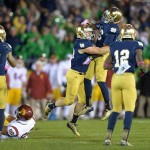 Oct 19, 2013; South Bend, IN, USA; Notre Dame Fighting Irish linebacker Joe Schmidt (38) celebrates with cornerback Cole Luke (36) after breaking up a pass intended for Southern California Trojans tight end Jalen Cope-Fitpatrick (88) in the fourth quarter at Notre Dame Stadium. Notre Dame defeated USC 14-10. Mandatory Credit: Kirby Lee-USA TODAY Sports