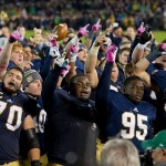 Oct 19, 2013; South Bend, IN, USA; Notre Dame Fighting Irish offensive tackle Zack Martin (70), nose tackle Louis Nix (1), defensive lineman Marquis Dickerson (95), and nose tackle Kona Schwenke (96) sing the Notre Dame Alma Mater after Notre Dame defeated the USC Trojans 14-10 at Notre Dame Stadium. Mandatory Credit: Matt Cashore-USA TODAY Sports