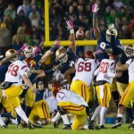 Oct 19, 2013; South Bend, IN, USA; USC Trojans kicker Andre Heidari (48) attempts a field goal as Notre Dame Fighting Irish defensive end Stephon Tuitt (7) and linebacker Jaylon Smith (9) defend in the fourth quarter. Notre Dame won 14-10. Mandatory Credit: Matt Cashore-USA TODAY Sports