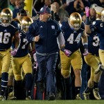 Oct 19, 2013; South Bend, IN, USA; Notre Dame Fighting Irish head coach Brian Kelly runs onto the field with his team prior the game against the USC Trojans at Notre Dame Stadium. Notre Dame won 14-10. Mandatory Credit: Matt Cashore-USA TODAY Sports