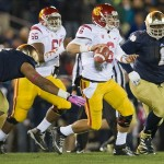 Oct 19, 2013; South Bend, IN, USA; USC Trojans quarterback Cody Kessler (6) is pressured by Notre Dame Fighting Irish defensive end Stephon Tuitt (7) and nose tackle Louis Nix (1) in the first quarter at Notre Dame Stadium. Notre Dame won 14-10. Mandatory Credit: Matt Cashore-USA TODAY Sports