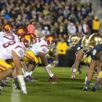 Oct 19, 2013; South Bend, IN, USA; General view of the line of scrimmage as Southern California Trojans center Marcus Martin (66) snaps the ball to quarterback Cody Kessler (6) against the Notre Dame Fighting Irish at Notre Dame Stadium. Notre Dame won 14-10. Mandatory Credit: Kirby Lee-USA TODAY Sports