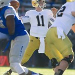 Oct 26, 2013; Colorado Springs, CO, USA; Notre Dame Fighting Irish quarterback Tommy Rees (11) throws in the second quarter against the Air Force Falcons at Falcon Stadium. Mandatory Credit: Matt Cashore-USA TODAY Sports
