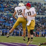Oct 26, 2013; Colorado Springs, CO, USA; Notre Dame Fighting Irish quarterback Andrew Hendrix (12) celebrates with quarterback Tommy Rees (11) after Hendrix scored a touchdown in the fourth quarter against the Air Force Falcons at Falcon Stadium. Notre Dame won 45-10. Mandatory Credit: Matt Cashore-USA TODAY Sports