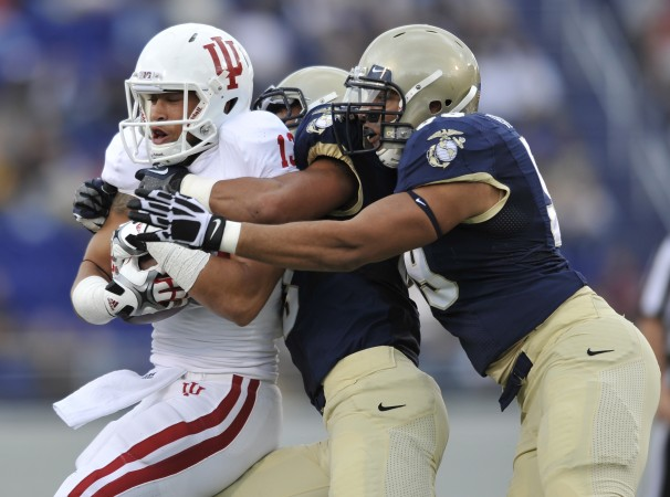 Navy's Jordan Drake, center, and Josh Dowling-Fitzpatrick helped wrap up Indiana. (Gail Burton/Associated Press)