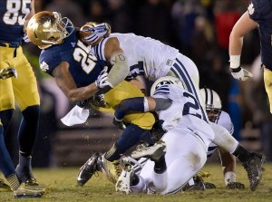 Nov 23, 2013; South Bend, IN, USA; Notre Dame Fighting Irish running back Tarean Folston (25) is tackled by BYU Cougars linebacker Uani