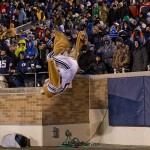 Nov 23, 2013; South Bend, IN, USA; The BYU Cougars mascot Cosmo does a backflip in the fourth quarter of the game between the BYU Cougars and the Notre Dame Fighting Irish at Notre Dame Stadium. Notre Dame won 23-13. Mandatory Credit: Matt Cashore-USA TODAY Sports