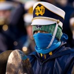 Nov 23, 2013; South Bend, IN, USA; Notre Dame marching band member Mike Buche bundles up against the cold weather during the game between the Notre Dame Fighting Irish and the BYU Cougars at Notre Dame Stadium. Notre Dame won 23-13. Mandatory Credit: Matt Cashore-USA TODAY Sports