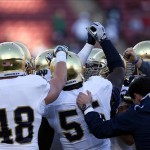 Nov 30, 2013; Stanford, CA, USA; Notre Dame Fighting Irish linebacker Prince Shembo (55, center) holds up his arm for a huddle before the game against the Stanford Cardinal at Stanford Stadium. Mandatory Credit: Kelley L Cox-USA TODAY Sports
