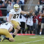 Nov 30, 2013; Stanford, CA, USA; Notre Dame Fighting Irish kicker Kyle Brindza (27) kicks a field goal with a hold by wide receiver Luke Massa (14) against the Stanford Cardinal during the first quarter at Stanford Stadium. Mandatory Credit: Kelley L Cox-USA TODAY Sports