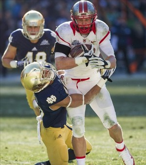 Dec 28, 2013; Bronx, NY, USA; Rutgers Scarlet Knights tight end Tyler Kroft (86) carries the ball as Notre Dame Fighting Irish safety Max Redfield (10) attempts to tackle in the second quarter of the Pinstripe Bowl at Yankee Stadium. Mandatory Credit: Matt Cashore-USA TODAY Sports