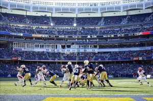 Dec 28, 2013; Bronx, NY, USA; A general view of game action between the Rutgers Scarlet Knights and the Notre Dame Fighting Irish during the first half of the Pinstripe Bowl at Yankees Stadium. Mandatory Credit: Joe Camporeale-USA TODAY Sports
