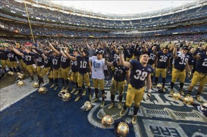 Dec 28, 2013; Bronx, NY, USA; The Notre Dame Fighting Irish sing their Alma Mater after the Pinstripe Bowl at Yankee Stadium. Notre Dame defeated the Rutgers Scarlet Knights 29-16. Mandatory Credit: Matt Cashore-USA TODAY Sports