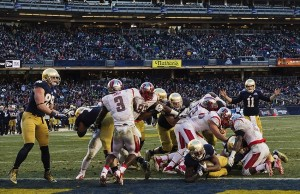 Dec 28, 2013; Bronx, NY, USA; Notre Dame Fighting Irish running back Tarean Folston (25) scores a touchdown in the fourth quarter against the Rutgers Scarlet Knights in the Pinstripe Bowl game at Yankee Stadium. Notre Dame won 29-16. Mandatory Credit: Matt Cashore-USA TODAY Sports