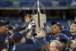 Dec 28, 2013; Bronx, NY, USA; Notre Dame Fighting Irish players celebrates with the trophy after defeating the Rutgers Scarlet Knights in the Pinstripe Bowl at Yankees Stadium. Notre Dame Fighting Irish won the game 29-16. Mandatory Credit: Joe Camporeale-USA TODAY Sports
