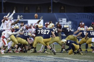 Dec 28, 2013; Bronx, NY, USA; Notre Dame Fighting Irish kicker Kyle Brindza (27) attempts a field goal against the Rutgers Scarlet Knights during the second half of the Pinstripe Bowl at Yankees Stadium. Notre Dame Fighting Irish won the game 29-16. Mandatory Credit: Joe Camporeale-USA TODAY Sports