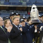 Dec 28, 2013; Bronx, NY, USA; Notre Dame Fighting Irish head coach Brian Kelly celebrates with the trophy after defeating the Rutgers Scarlet Knights in the Pinstripe Bowl at Yankees Stadium. Notre Dame Fighting Irish won the game 29-16. Mandatory Credit: Joe Camporeale-USA TODAY Sports