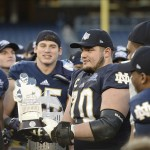 Dec 28, 2013; Bronx, NY, USA; Notre Dame Fighting Irish offensive tackle Zack Martin (70) is awarded the game