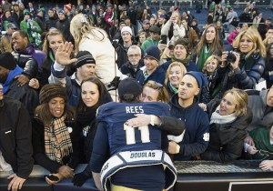 Dec 28, 2013; Bronx, NY, USA; Notre Dame Fighting Irish quarterback Tommy Rees (11) greets fans after Notre Dame defeated the Rutgers Scarlet Knights 29-16 in the Pinstripe Bowl at Yankee Stadium. Mandatory Credit: Matt Cashore-USA TODAY Sports