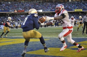 Dec 28, 2013; Bronx, NY, USA; Rutgers Scarlet Knights defensive back Lorenzo Waters (21) defends a pass against Notre Dame Fighting Irish wide receiver TJ Jones (7) during the second half of the Pinstripe Bowl at Yankees Stadium. Notre Dame Fighting Irish won the game 29-16. Mandatory Credit: Joe Camporeale-USA TODAY Sports