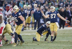 Dec 28, 2013; Bronx, NY, USA; Notre Dame Fighting Irish kicker Kyle Brindza (27) watches his field goal in the fourth quarter against the Rutgers Scarlet Knights in the Pinstripe Bowl at Yankee Stadium. Notre Dame won 29-16. Mandatory Credit: Matt Cashore-USA TODAY Sports
