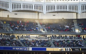 Dec 28, 2013; Bronx, NY, USA; The sun sets behind Yankee Stadium during the Pinstripe Bowl game between the Rutgers Scarlet Knights and the Notre Dame Fighting Irish. Notre Dame won 29-16. Mandatory Credit: Matt Cashore-USA TODAY Sports