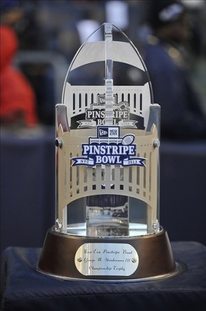 Dec 28, 2013; Bronx, NY, USA; A look at the trophy during the second half of the Pinstripe Bowl between the Rutgers Scarlet Knights and the Notre Dame Fighting Irish at Yankees Stadium. Notre Dame Fighting Irish won the game 29-16. Mandatory Credit: Joe Camporeale-USA TODAY Sports