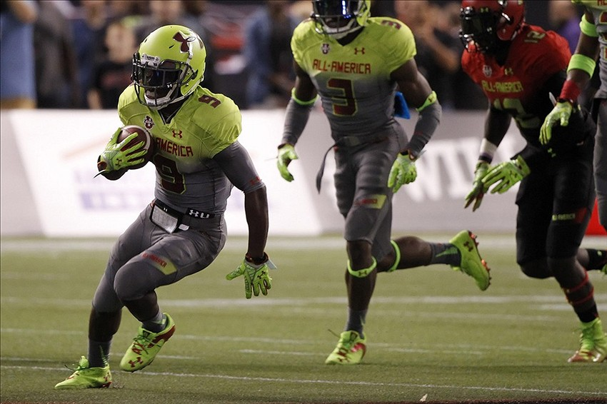 Jan 2, 2014; St. Petersburg, FL, USA; Team Nitro wide receiver Isaiah McKenzie (9) runs with the ball during the second half at Tropicana Field. Team Highlight defeated the Team Nitro 31-21. Mandatory Credit: Kim Klement-USA TODAY Sports